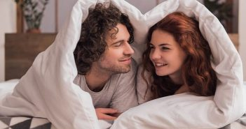 couple in bed asking each other questions