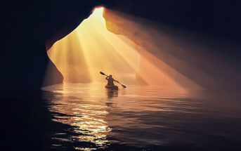person in canoe inside cave - doing some soul searching