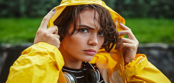 young unhappy woman in bright yellow coat to illustrate sucking at life