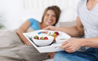 man bringing partner breakfast in bed - illustrating treating someone well