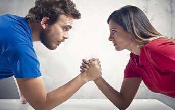 man and woman having arm wrestle because they always need to be right
