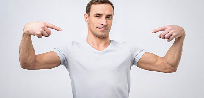 man pointing at himself to illustrate bragging