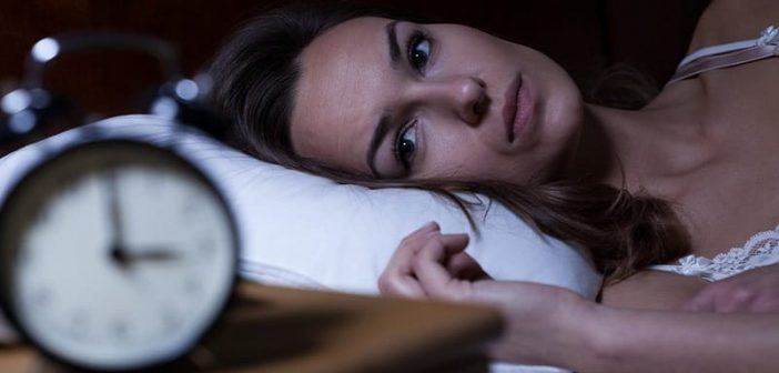insomniac woman awake at 3am - how to function on no sleep