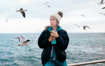 a woman at the coast with seagulls - illustrating that she has lost herself in a relationship