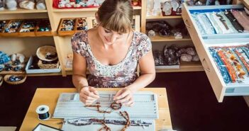 woman making a necklace illustrating finding a hobby