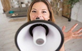 woman speaking into megaphone to illustrate someone who talks loud
