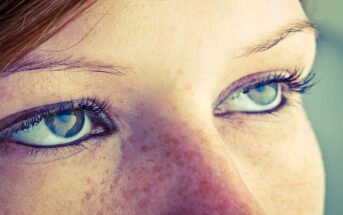 closeup of woman's eyes look bored with no passion
