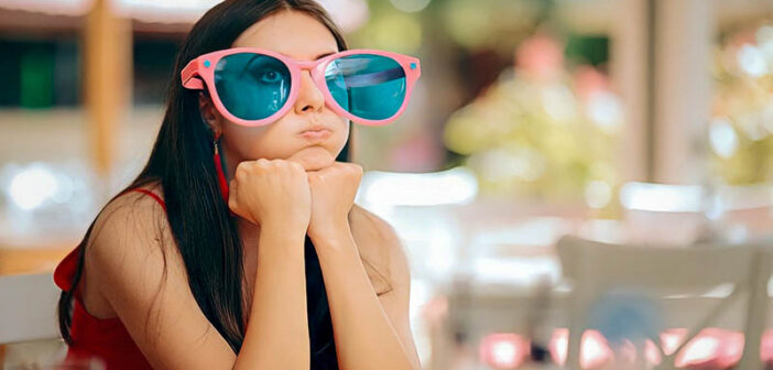 woman with big funny glasses on - illustrating being a more interesting person