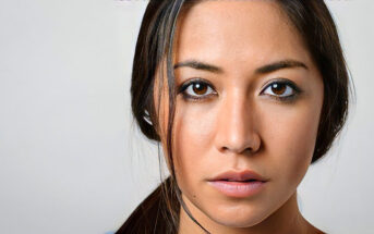 woman with a blank stare on her face illustrating emotional numbness