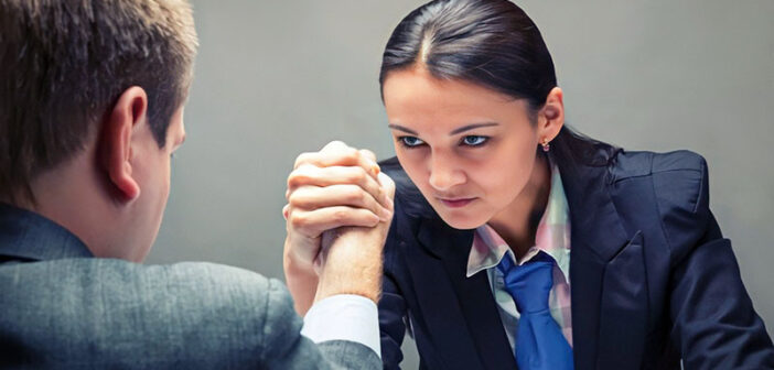 young businesswoman arm wrestling businessman to illustrate earning respect from others