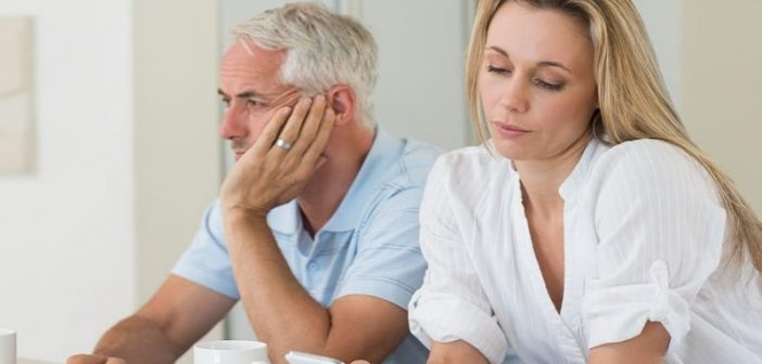middle aged couple appearing distant to one another - illustrating loneliness in a marriage