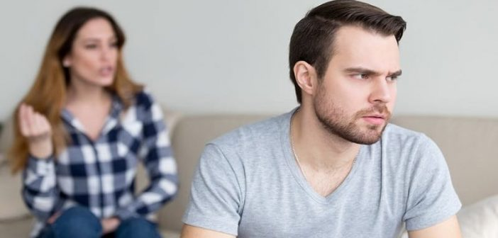 man and woman looking resentful toward each other
