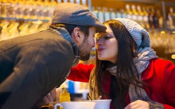 couple kissing in bar - illustrating falling in love too easily