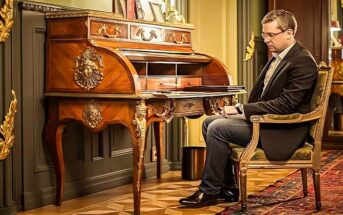 sad wealthy man sitting alone in luxury home illustrating that money can't buy happiness