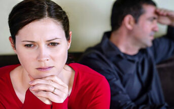 woman looking sad with husband in background - illustrating feeling trapped in a marriage
