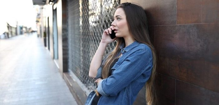 annoyed woman talking on the phone to absent boyfriend who doesn't have time for her