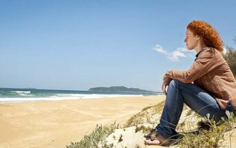 woman looking out across ocean wondering what things to believe in