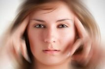 woman with fingers on face with blurred background - illustrating not knowing what to do