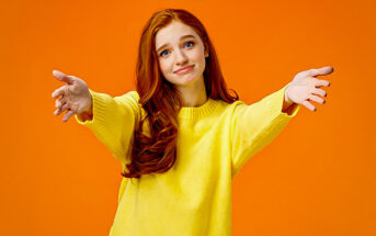 woman with open arms offering to hug - illustrating cheering someone up