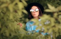 woman in bushes spying on her ex who has moved on
