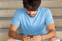 guy looking down at his phone illustrating that he likes to text but not call