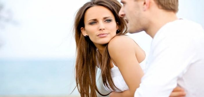 woman listening to guy speak after asking him where the relationship is going