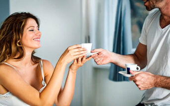 man bringing woman a cup of tea in bed illustrating the acts of service love language