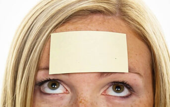 woman with sticky note on her forehead - illustrating labeling people
