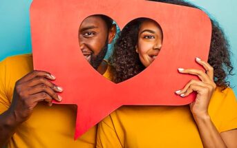 man and woman holding speech bubble between them with love heart cut out - illustrating the five love languages