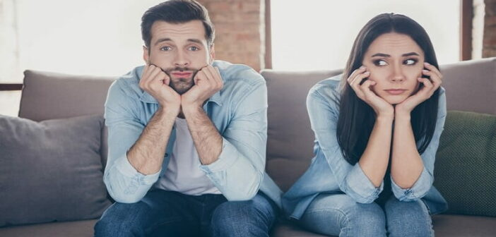 couple looking bored with woman wondering how to make him miss her like crazy