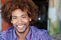 African American man smiling - illustrating the good qualities to look for in a man