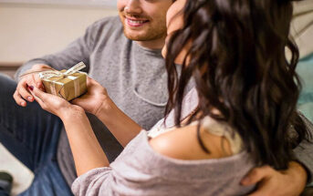 man giving woman a present illustrating the receiving gifts love language