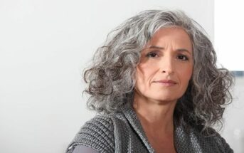middle aged woman with gray hair illustrating wisdom and intelligence