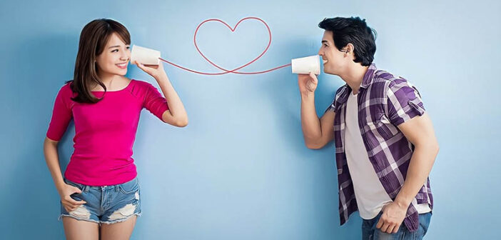 couple using cans and string to communicate their words of affirmation to each other