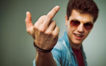abrasive man giving the finger sign