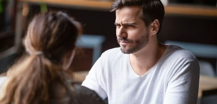 a guy looking confused and doubtful at girl - illustrating that he doesn't know what he wants