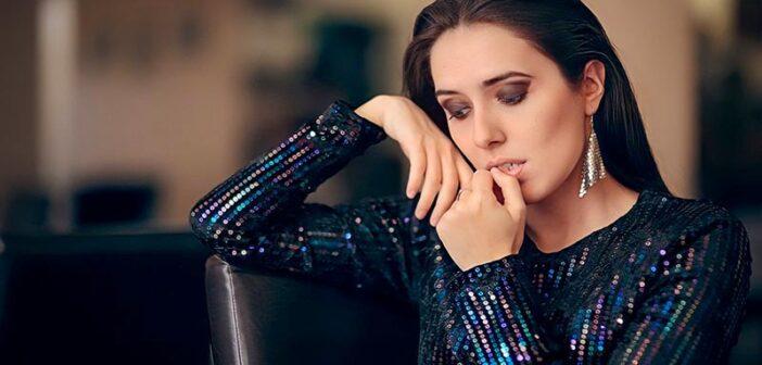 socially awkward woman looking anxious at party