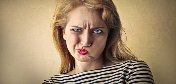 woman with scrunched up face illustrating annoyance