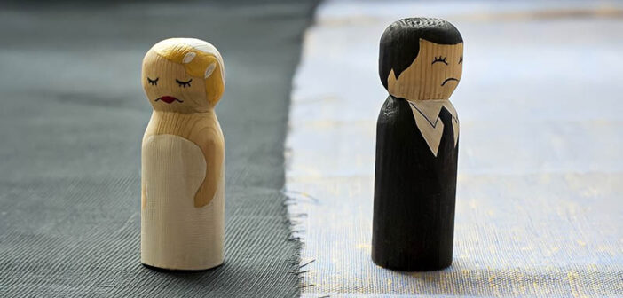 bride and groom figures looking unhappy illustrating it's time to divorce