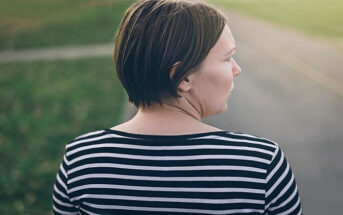 woman looking down a road wanting to run away from life