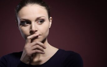 pensive woman thinking about her mistakes so that she may learn from them