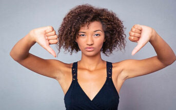 woman with both her thumbs down illustrating complaining about things