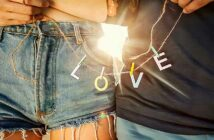 closeup of couple holding string with l-o-v-e letters