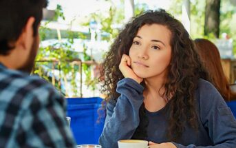 young woman looking at date unsure whether she is attracted to him and whether attraction can grow