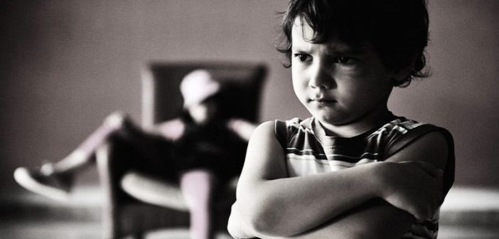 black and white photo of young siblings not getting on to illustrate estranged siblings