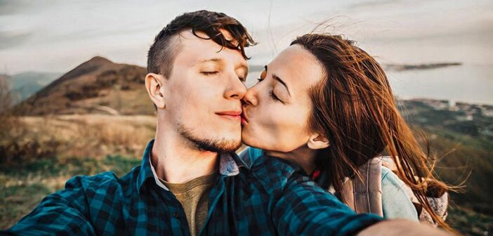 couple sharing tender kiss illustrating getting the spark back in a relationship