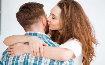 woman cuddling and kissing boyfriend to illustrate loving too much
