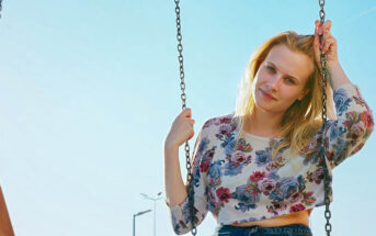 woman on swing because she misses her childhood
