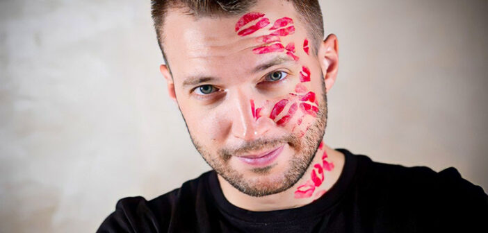 man with lots of lipstick kiss marks on his face illustrating that he is a player