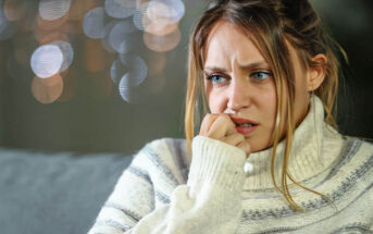 woman biting her nails illustrating that she is scared of dating